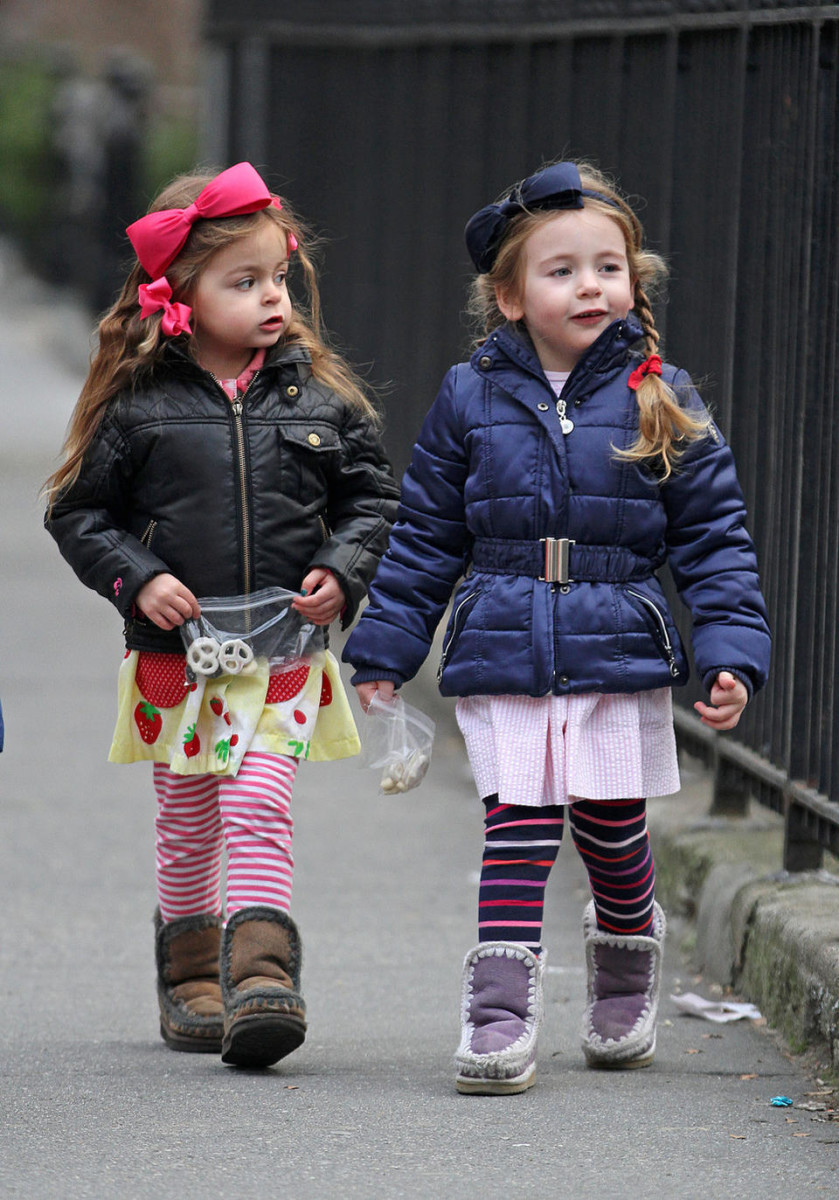 Twins Marion and Tabitha Broderick enjoy a day of playground fun with each other in New York City